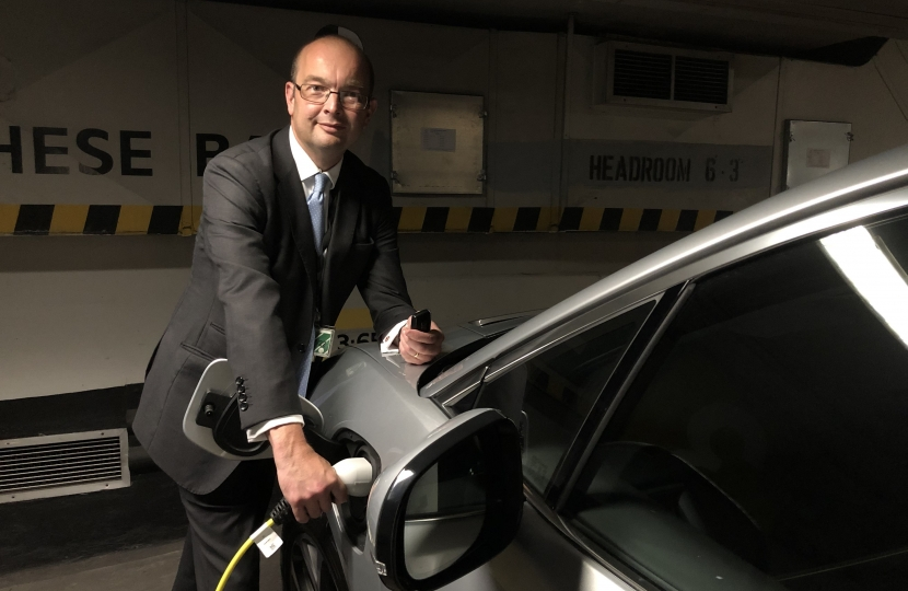 James Duddridge charging the electric car inside Parliament